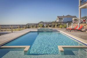 pool bauen lassen: Was kostet ein Swimmingpool? Poolbau Kosten berechnen.